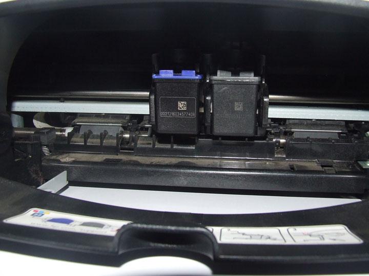 Ink cartridges slide into position